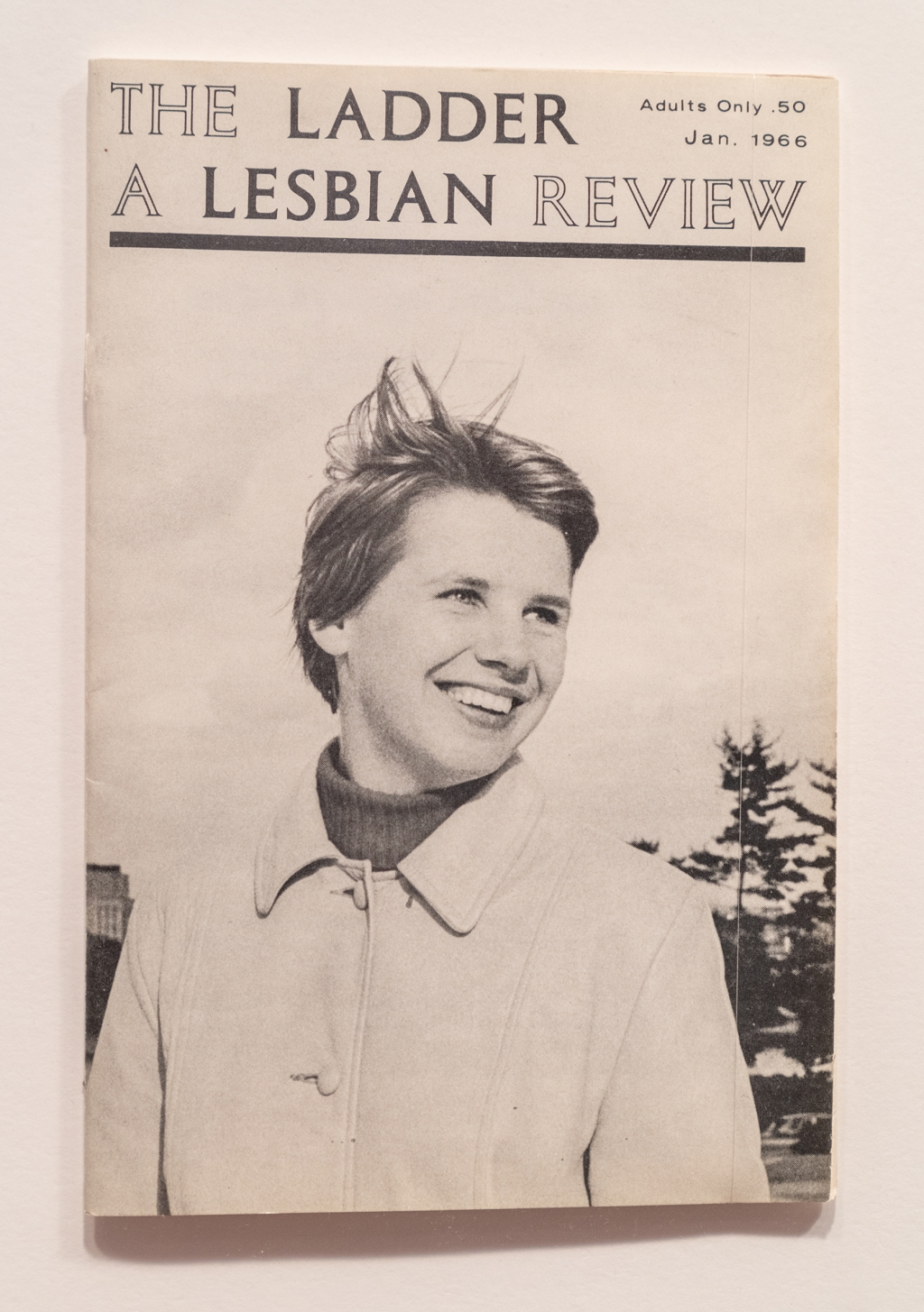 """""""In order to have this political movement, you had to have magazines,"""" says Baumann, """"There's no internet, so how else do people communicate?"""" In the 1960s, every gay rights organization had their own publication. The Daughters of Bilitis published The Ladder every month from 1956 to 1970. Before Kay Tobin Lahusen took over as the photo editor, the cover was typically a cartoon or a woman in silhouette. In the mid-1960s, Lehusen started putting out-lesbians' faces on the cover of the magazine. """"I think it would be hard to see how radical this picture is because it's this 'Ellen' sort of image,"""" says Baumann. """"She's the first out american lesbian to be on a cover of a magazine. But this is also the first [picture of a] happy lesbian in American history. There are no happy depictions of lesbians prior to this picture — lesbians were depicted as homicidal, mentally ill. So it's really revolutionary."""""""