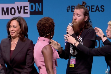 Protester Storms Stage, Grabs Mic from Kamala Harris at