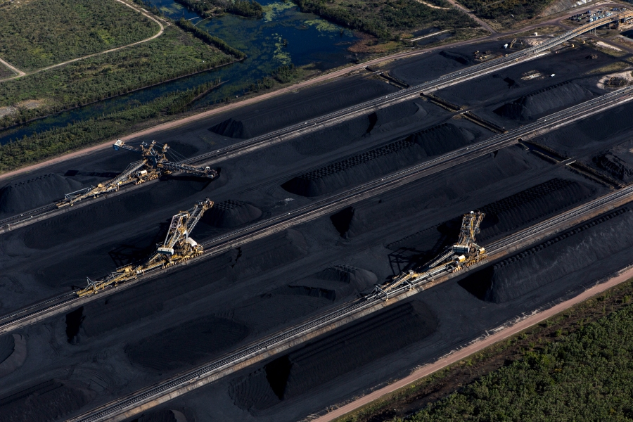 FILE -- Coal awaiting export at the Abbot Point coal terminal, in Queensland, Australia, July 5, 2017. Australia has approved the Adani Group's Carmichael coal mine project, which would export through this port. The vast project had been tied up in court challenges and protests by environmentalists since it was first proposed eight years ago. (David Maurice Smith/The New York Times)