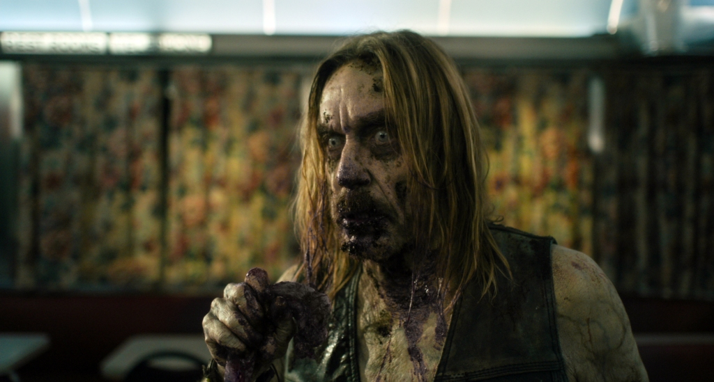 "Iggy Pop stars as ""Male Coffee Zombie"" in writer/director Jim Jarmusch's THE DEAD DON'T DIE, a Focus Features release. Credit : Frederick Elmes / Focus Features © 2019 Image Eleven Productions, Inc."