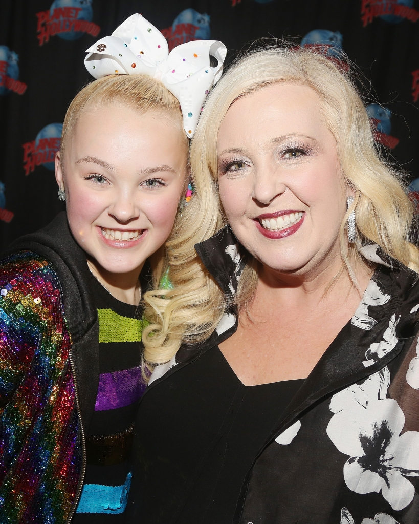 "NEW YORK, NY - FEBRUARY 19: JoJo Siwa and mother Jessalynn Siwa pose as JoJo Siwa hosts a screening of her new Nickelodeon movie ""Blurt"" at Planet Hollywood Times Square on February 19, 2018 in New York City. (Photo by Bruce Glikas/Bruce Glikas/Getty Images)"