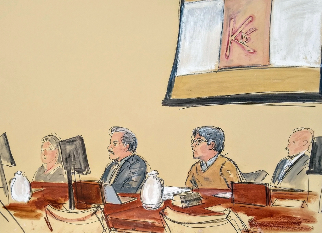 "In this courtroom artist's sketch, Keith Raniere, second from right, leader of the secretive group NXIVM, attends his trial in Brooklyn federal court, in New York. Above him is a screen with an image of a branding, containing his initials KR. A federal prosecutor says the self-help guru used threats, ""shame and humiliation"" while grooming women for sex. She also described how some female followers were branded with Raniere's initialsBranded Women, New York, USA - 07 May 2019"