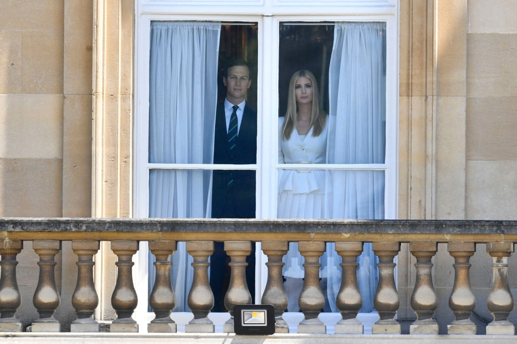 Jared Kushner and Ivanka Trump peer out of Buckingham Palace. This is not a still from a horror movie.