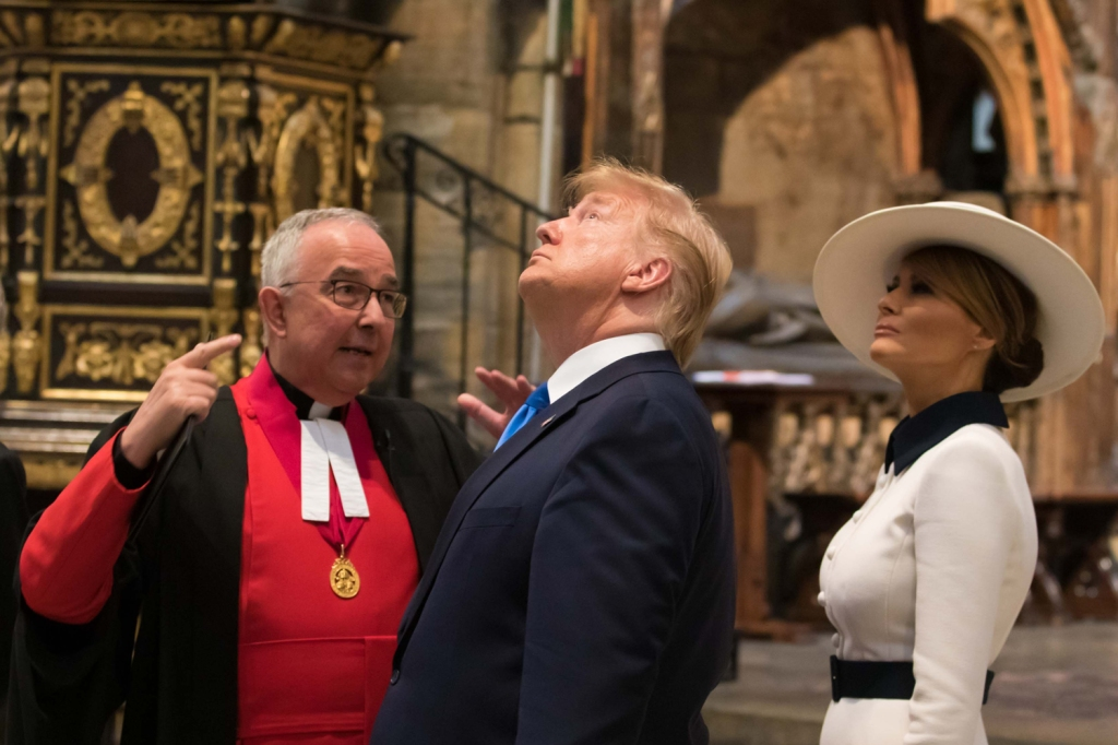 Trump did a lot of inspecting on his trip. Here he take a look at Westminster Abbey along with the first lady and the Very Reverend John Hall.