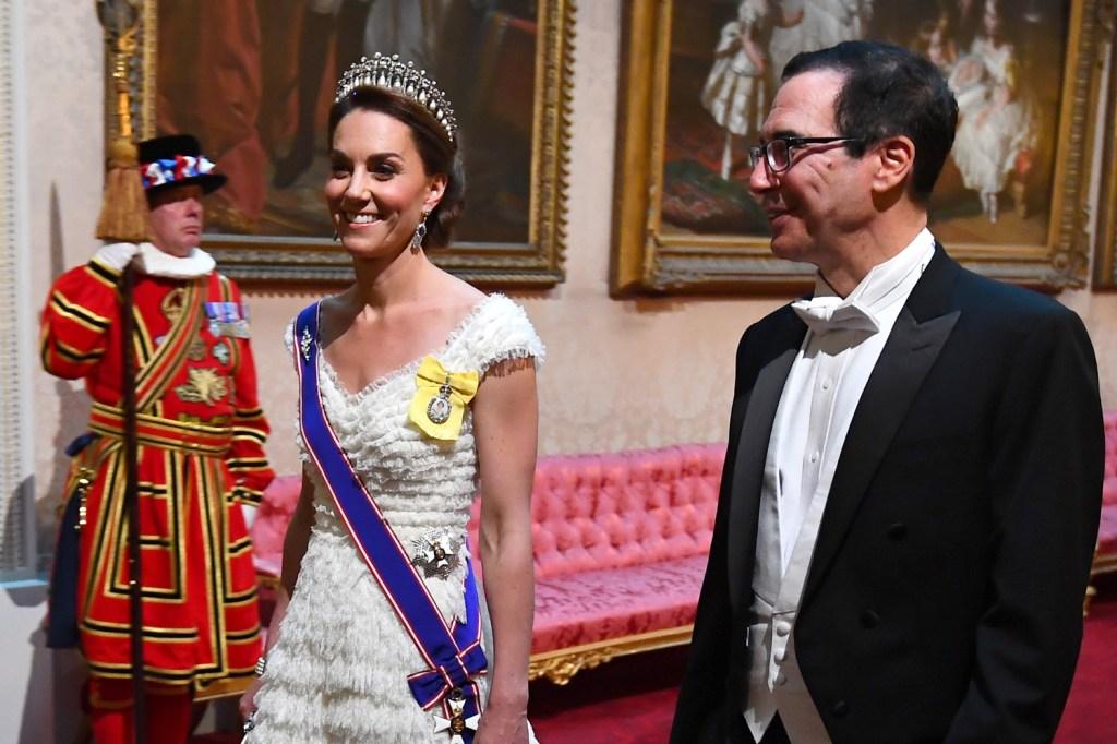 Treasure Secretary Steve Mnuchin strolls through Buckingham Palace with Catherine Duchess of Cambridge.