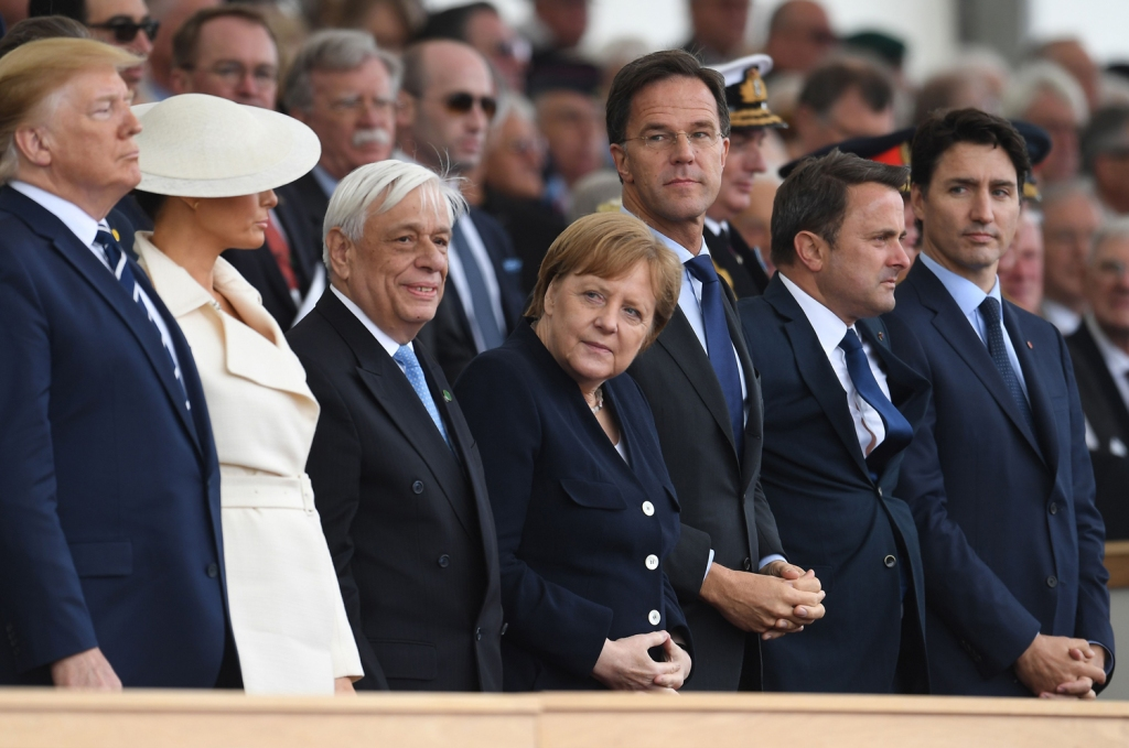 German President Angela Merkel and Canadian Prime Minister Justin Trudeau cast Trump some side eye during an event to commemorate the 75th anniversary of D-Day.