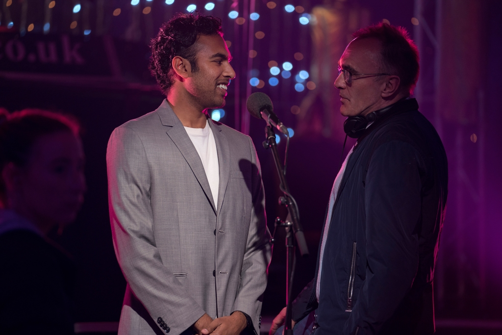 "(from left) Himesh Patel and director Danny Boyle on the set of ""Yesterday."""