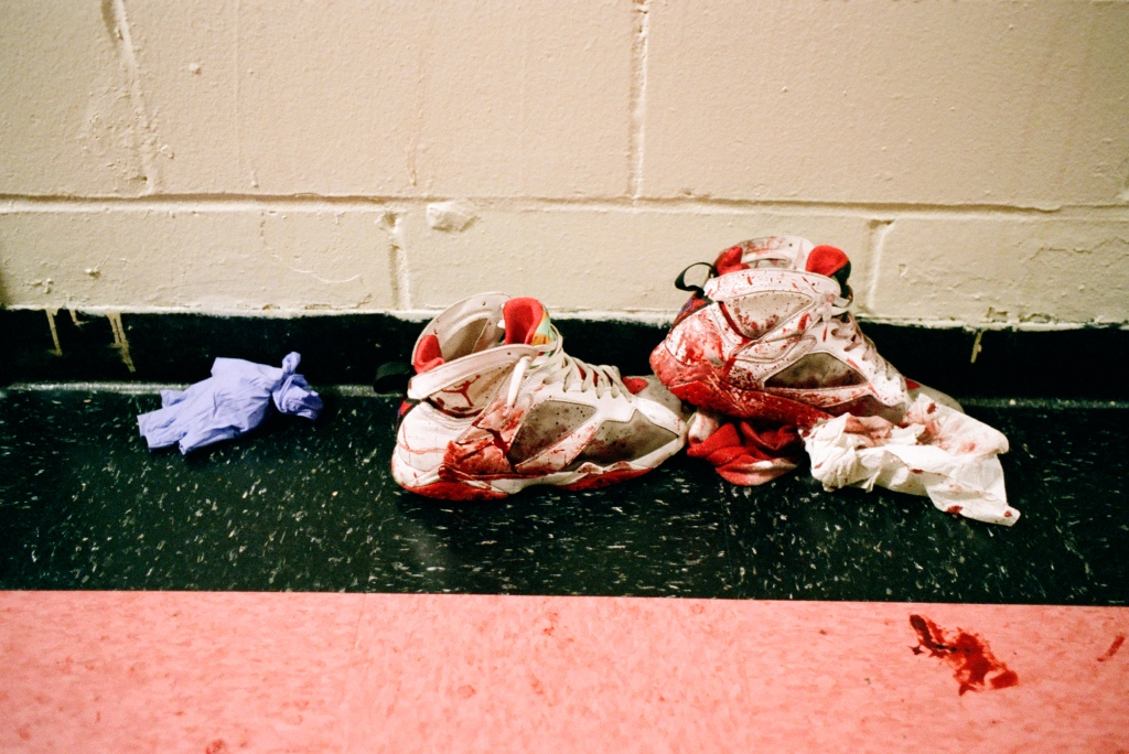 """First-responders leave a trail of latex gloves and bloody tissues near a pair of Jordans after two men were injured in a shootout at an East New York housing project. """"The first thing [you need] to get your perp,"""" says Herrera, """"you gotta know your victim."""" A suspect's habits, which used to require months of research and observation, can now be established after an afternoon scrolling through their Facebook profile."""