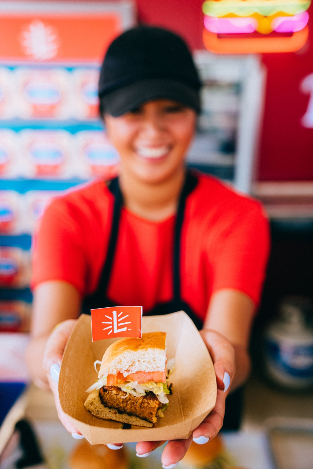 "Guests who stopped by the ""Burger & Beats"" tent were served a complimentary Lightlife Burger with custom Austin flavors and toppings. Paid partnership with Lightlife Foods."