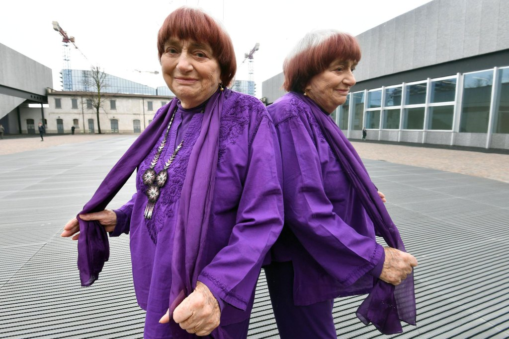 French film director Agnes Varda is reflected in a mirror as she attends a press screening of her documentary film 'Visages, villages' (Faces Places) at the Prada Foundation in Milan, Italy, March 2018.