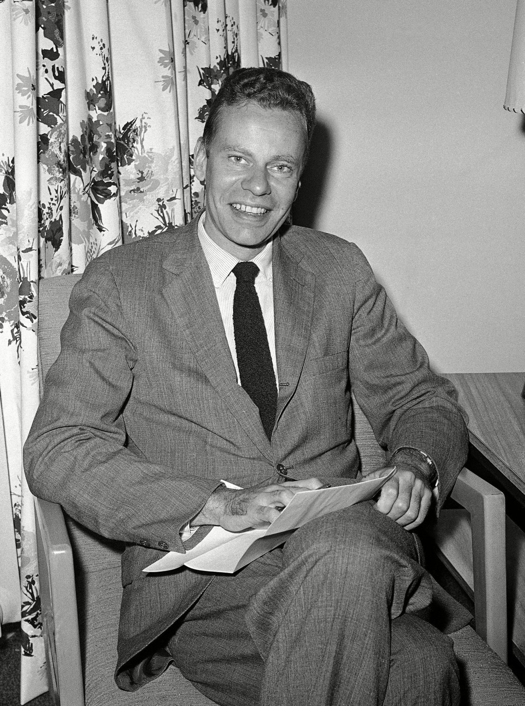 """Charles Van Doren, who won thousands of dollars on television quiz show, """"Twenty One"""" and who has been sought by congressional subcommittee investigation giveaway shows, is shown in New York's hotel Roosevelt."""