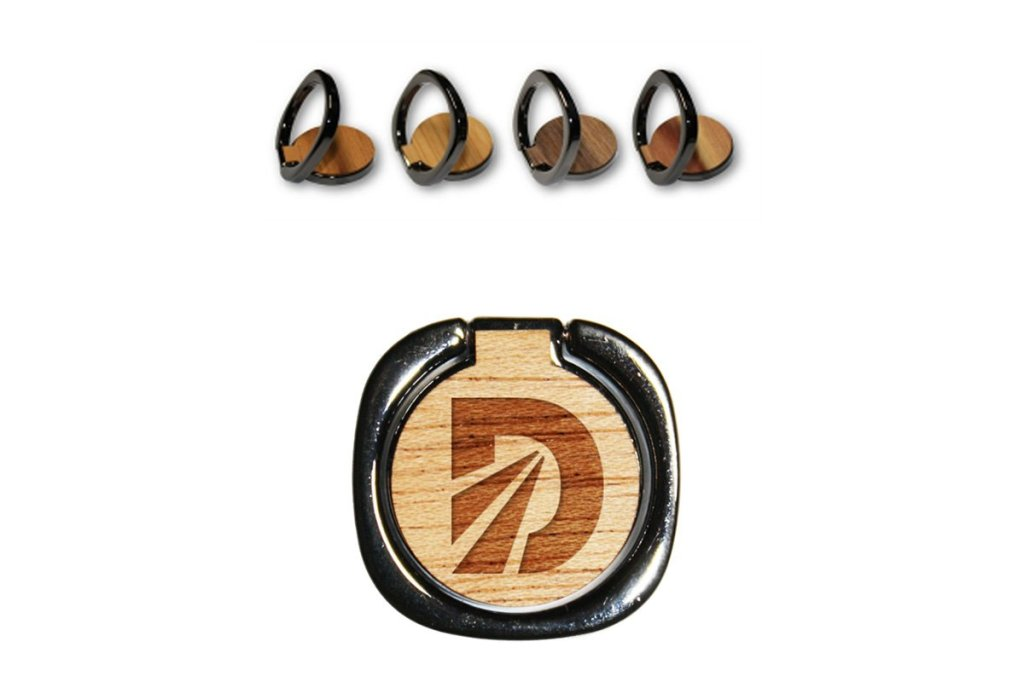 """From the website's description: """"Beyoncé Was Right. If you love your phone, put a ring on it! Yes, now you can show the world that you and your phone have that special bond when you use the Delaney for President genuine, wood, ring phone holder and stand. Only John's campaign helps you get a grip and take a stand, both at the same time."""" We'll pass."""