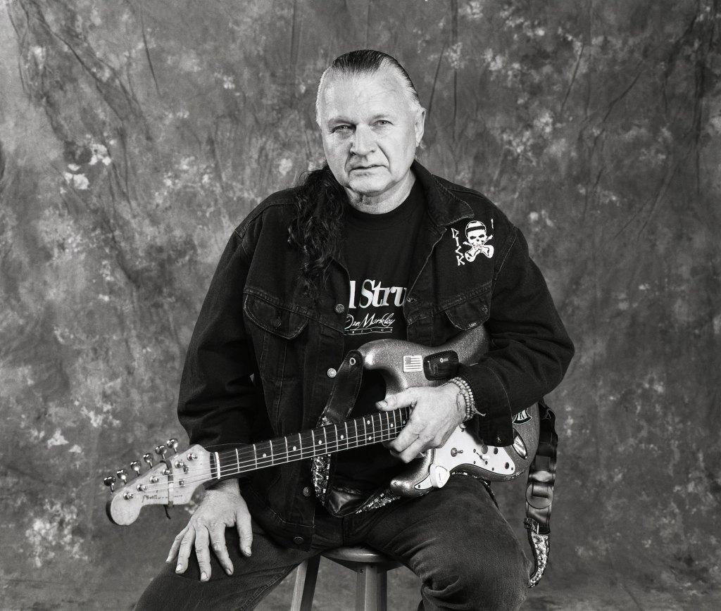 Dick Dale, with a Fender Stratocaster guitar.