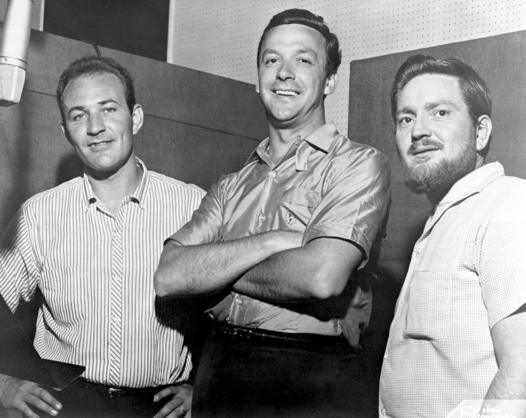 Fred Foster, president of Monument Records, poses with his newest signees, Fred Carter (left) and Willie Nelson in circa 1960.