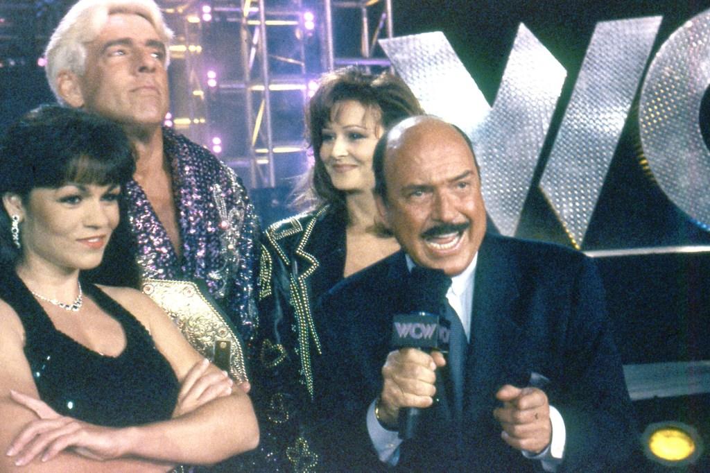 Woman, Ric Flair, Miss Elizabeth and Gene Okerlund circa 1998 during a WCW braodcast.
