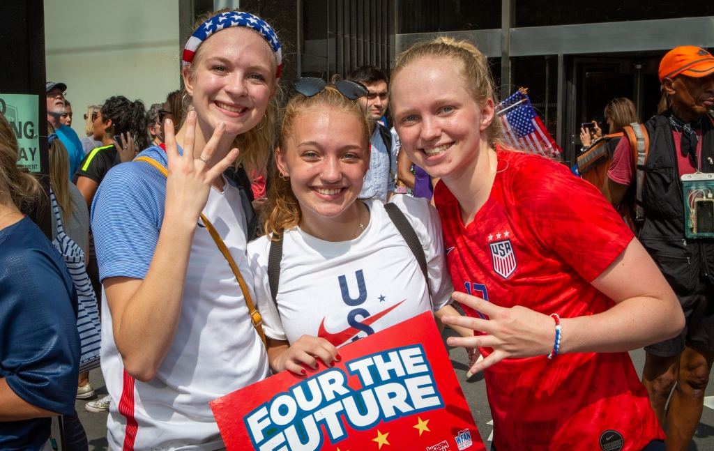 """Hailie Searles, Sage Garrison, and Kennedy Heichel, all made the trek from Ithaca, New York. """"In 2015, we went to Canada for the World Cup. We just graduated recently and wanted to celebrate so we drove here from Ithaca to show our support,"""" says Heichel, 17. """"Plus I am very impulsive."""" As for Searles, 21, she just wanted to see her idols. """"We have been playing soccer for ages and these women have inspired me from the beginning,"""" she explains."""