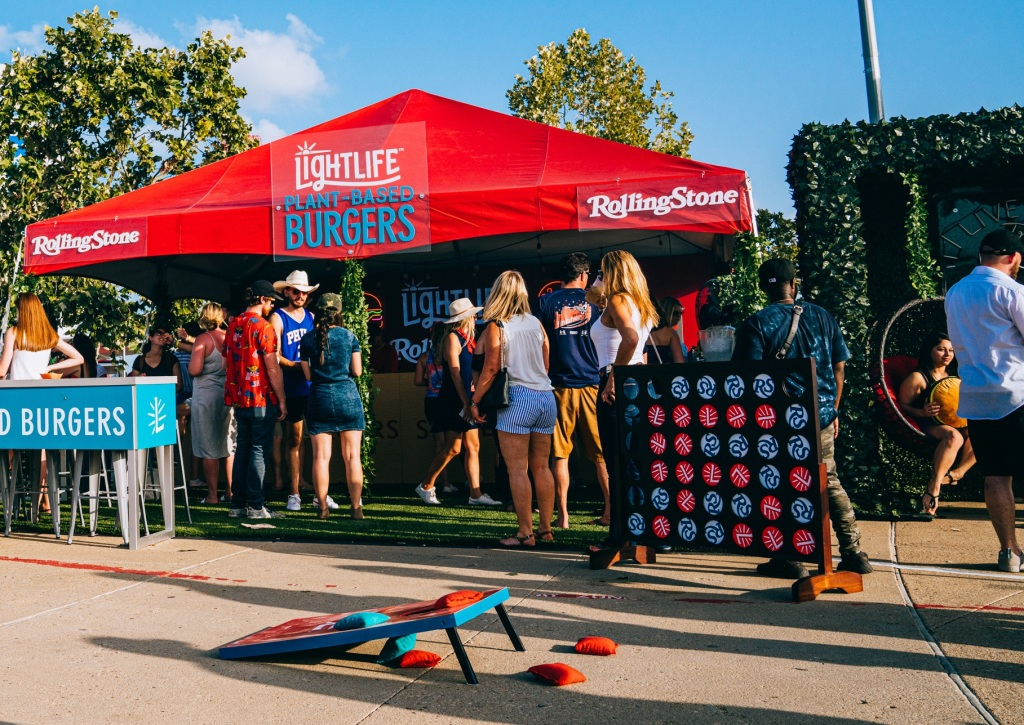 "Guests enjoyed lawn games, like cornhole, at the ""Burger & Beats"" lounge in between performances. Paid partnership with Lightlife Foods."