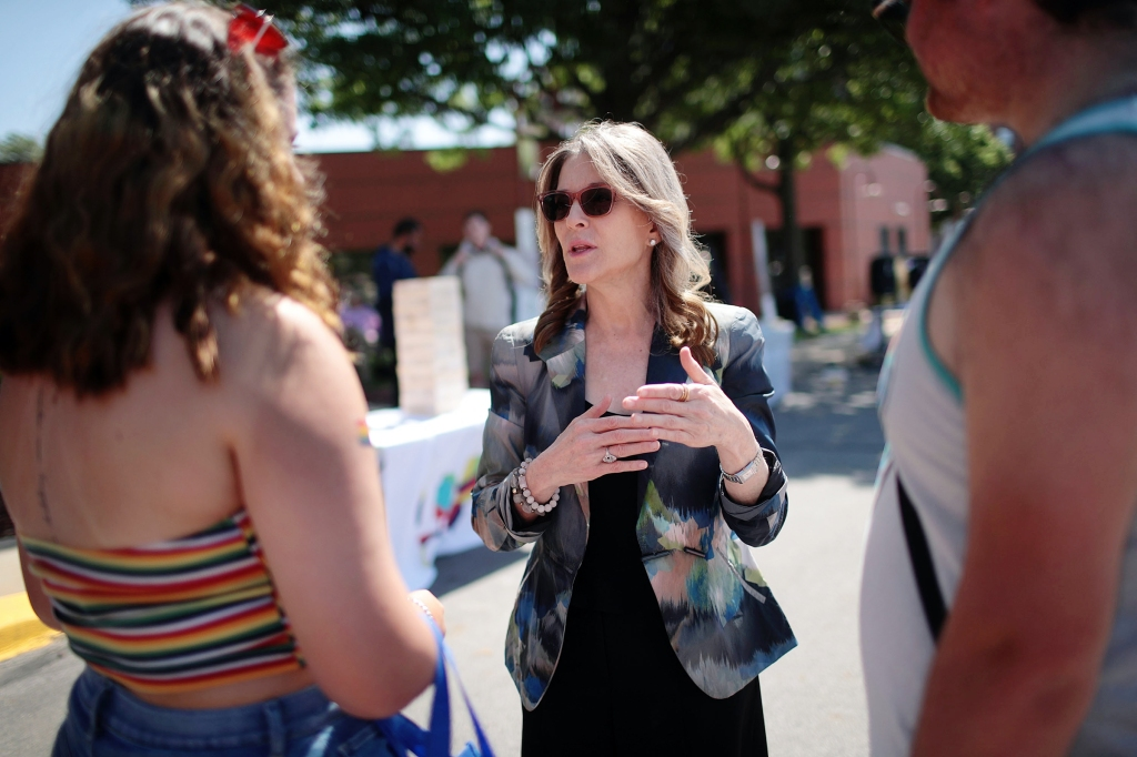 DES MOINES, IOWA - JUNE 08: Democratic presidential candidate and self-help author Marianne Williamson greets people while campaigning at the Capital City Pride Fest on June 08, 2019 in Des Moines, Iowa. Most of the more than 20 candidates seeking the Democratic nomination for president are campaigning at various locations in Iowa this weekend. (Photo by Scott Olson/Getty Images)