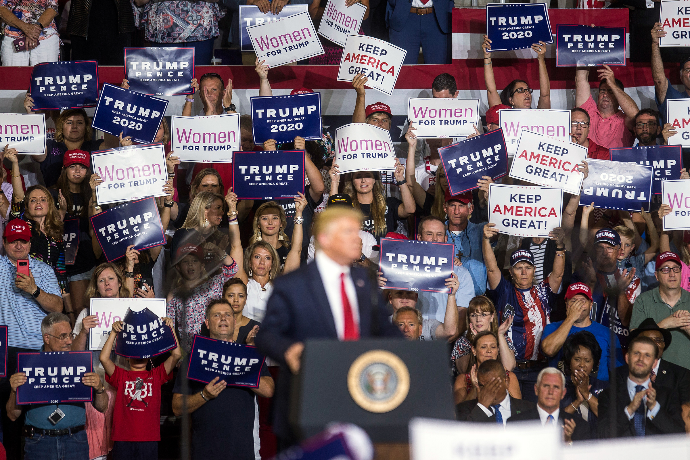 GREENVILLE, NC - JULY 17: Supporters of President Donald Trump cheer as he speaks during a Keep America Great rally on July 17, 2019 in Greenville, North Carolina. Trump is speaking in North Carolina only hours after The House of Representatives voted down an effort from a Texas Democrat to impeach the President. (Photo by Zach Gibson/Getty Images)