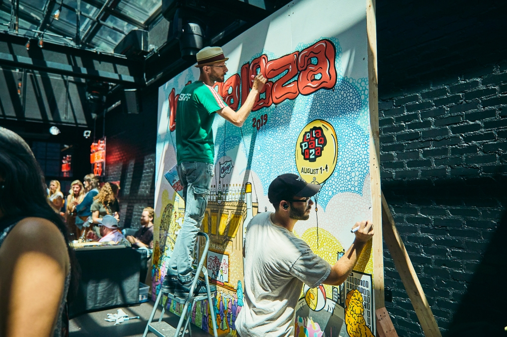 Local artist Zissou Tasseff-Elenkoff brought the festival to life through a hand crafted mural presented by Tito's Handmade Vodka