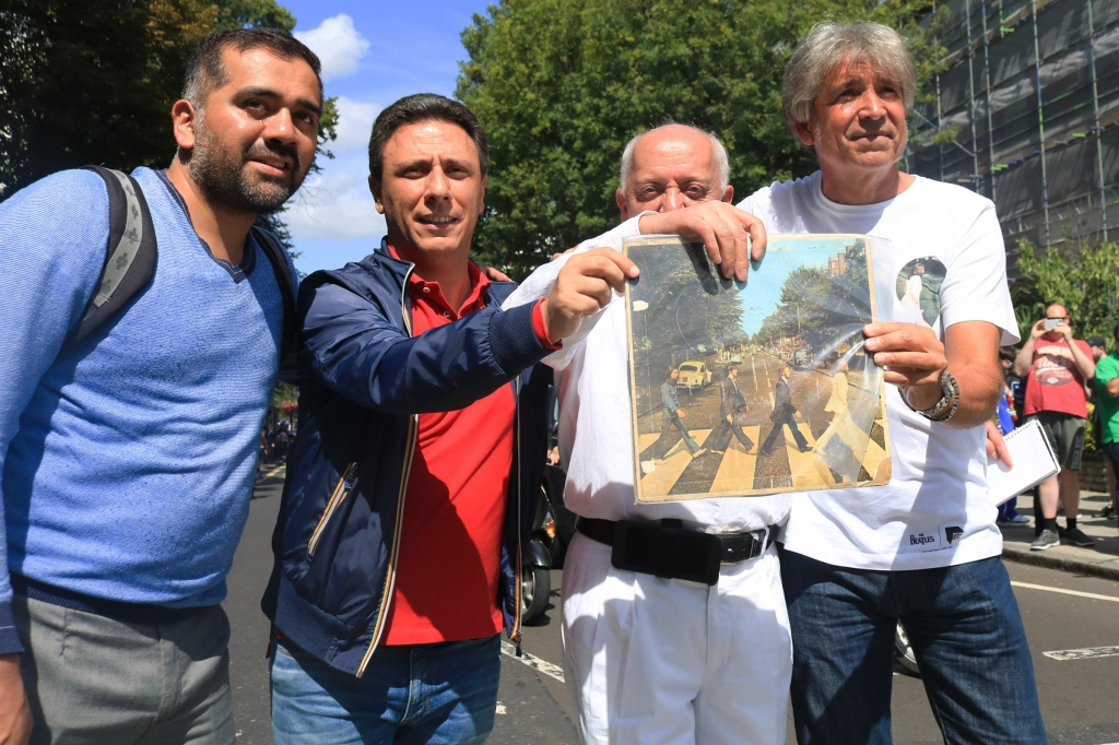 Music fans showing their original copy of the Abbey Road album.