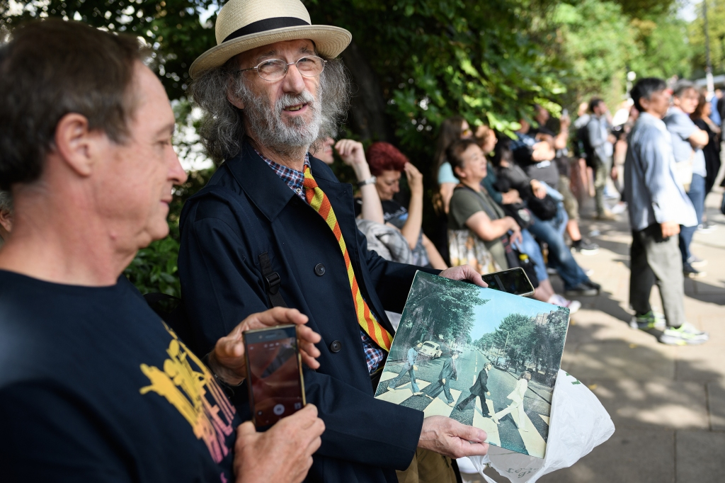 "A man holds his original copy of the Beatles album ""Abbey Road""."