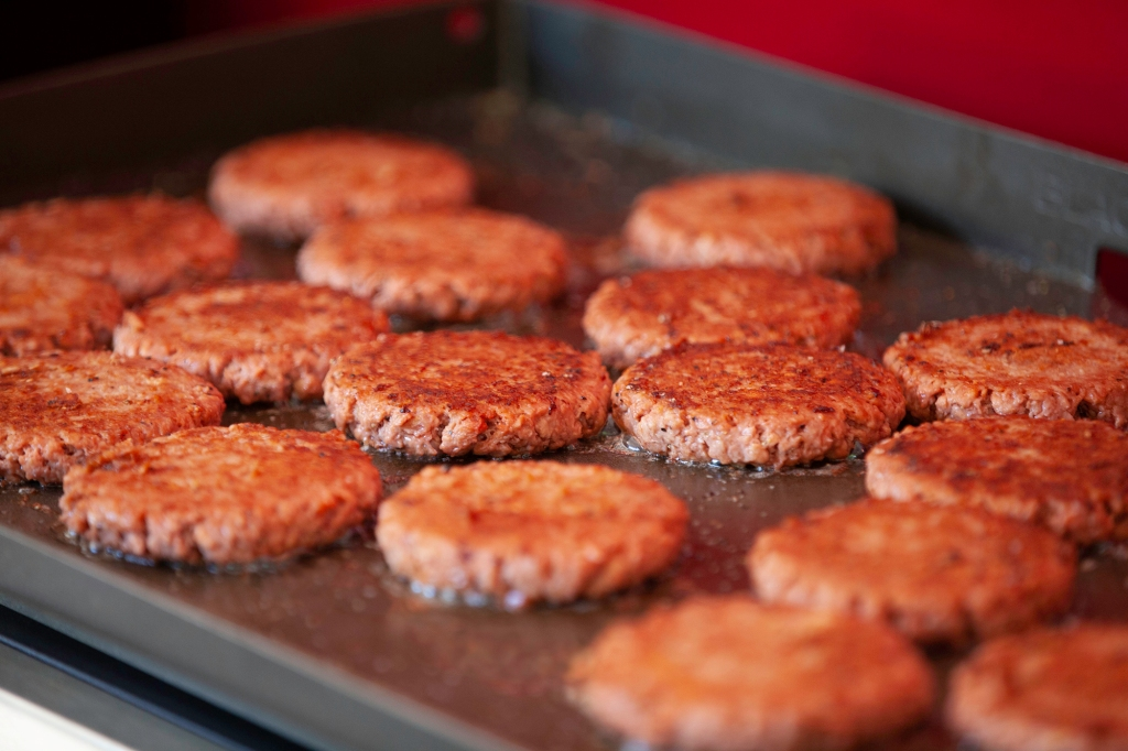 Juicy Lightlife Plant-Based Burgers on the grill. Paid partnership with Lightlife Foods.
