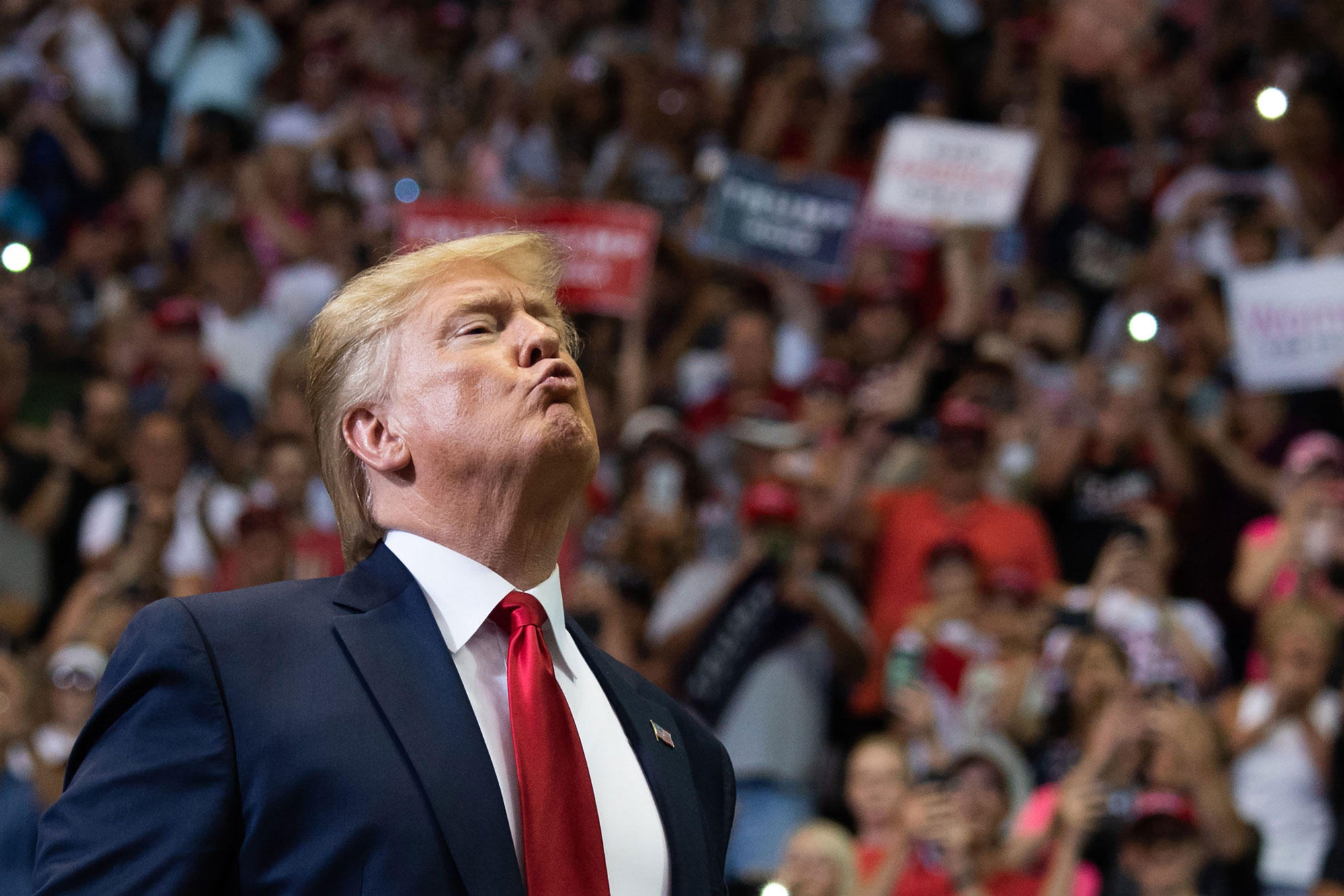 "TOPSHOT - US President Donald Trump gestures as he arrives to a ""Make America Great Again"" campaign rally in Cincinnati, Ohio, on August 1, 2019. (Photo by SAUL LOEB / AFP) (Photo credit should read SAUL LOEB/AFP/Getty Images)"