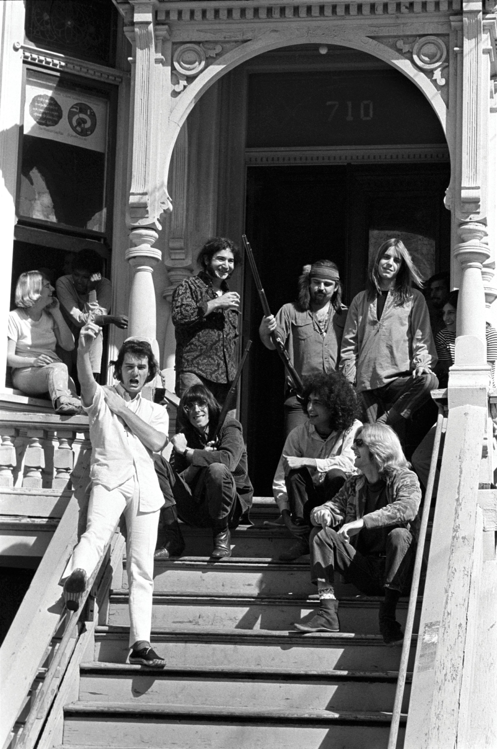 """The Grateful Dead reluctantly posing outside their San Francisco home in 1967 after a drug bust. """"I thought, 'Oh shit, if I get out of here with my life, I'll be lucky,'"""" Wolman recalls. """"They were just flipping me the bird, pointing their guns at me, having a great old time at my expense. I had a problem gathering them together out on the porch. They said, 'Well, who are you? Where are you from?"""" I said 'Rolling Stone.' They said, 'What's Rolling Stone?' We hadn't even published [the first issue] yet."""""""