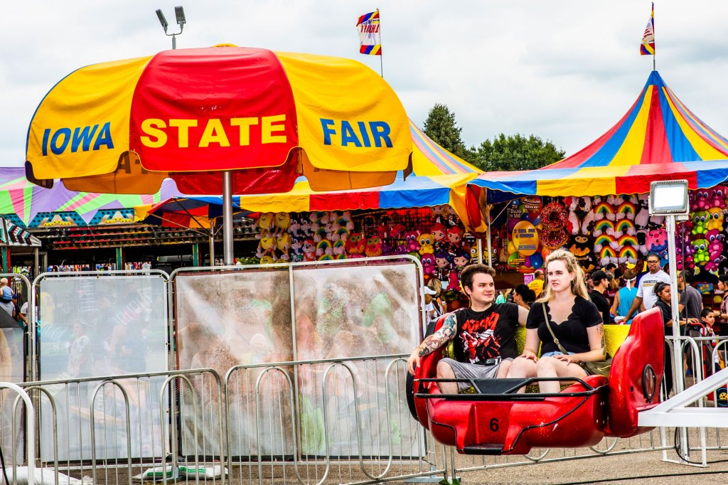 Two Slipknot fans sit on a ride at the Iowa State Fair in Des Moines, Iowa on August 10, 2019.
