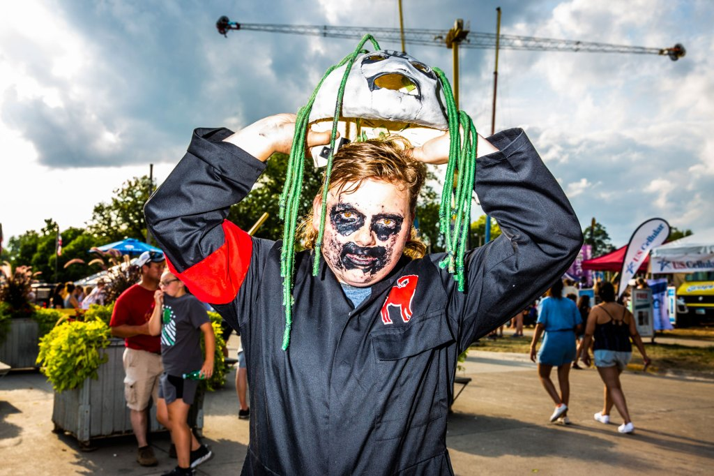 Jake Posson (from Sioux City, Iowa) puts on a mask before Slipknot's homecoming show at the Iowa State Fair in Des Moines, Iowa on August 10, 2019.