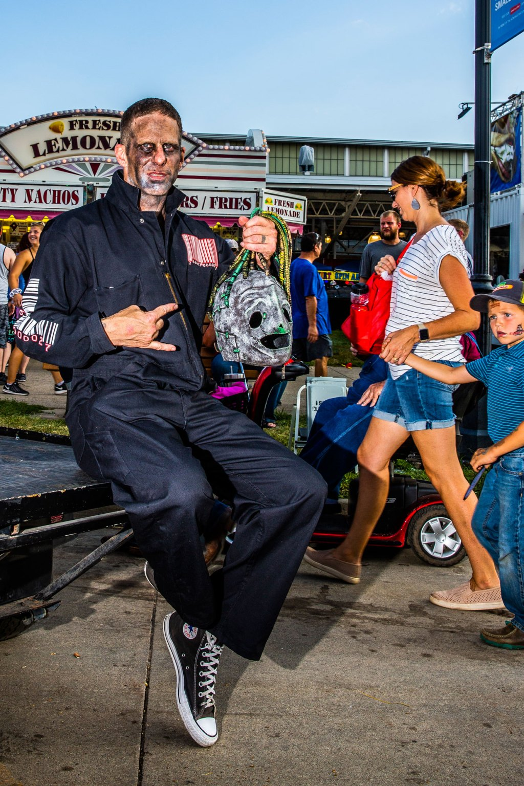 Chad Gross (from Oakland, California) sits on a golf cart before attending Slipknot's homecoming show at the Iowa State Fair in Des Moines, Iowa on August 10, 2019.