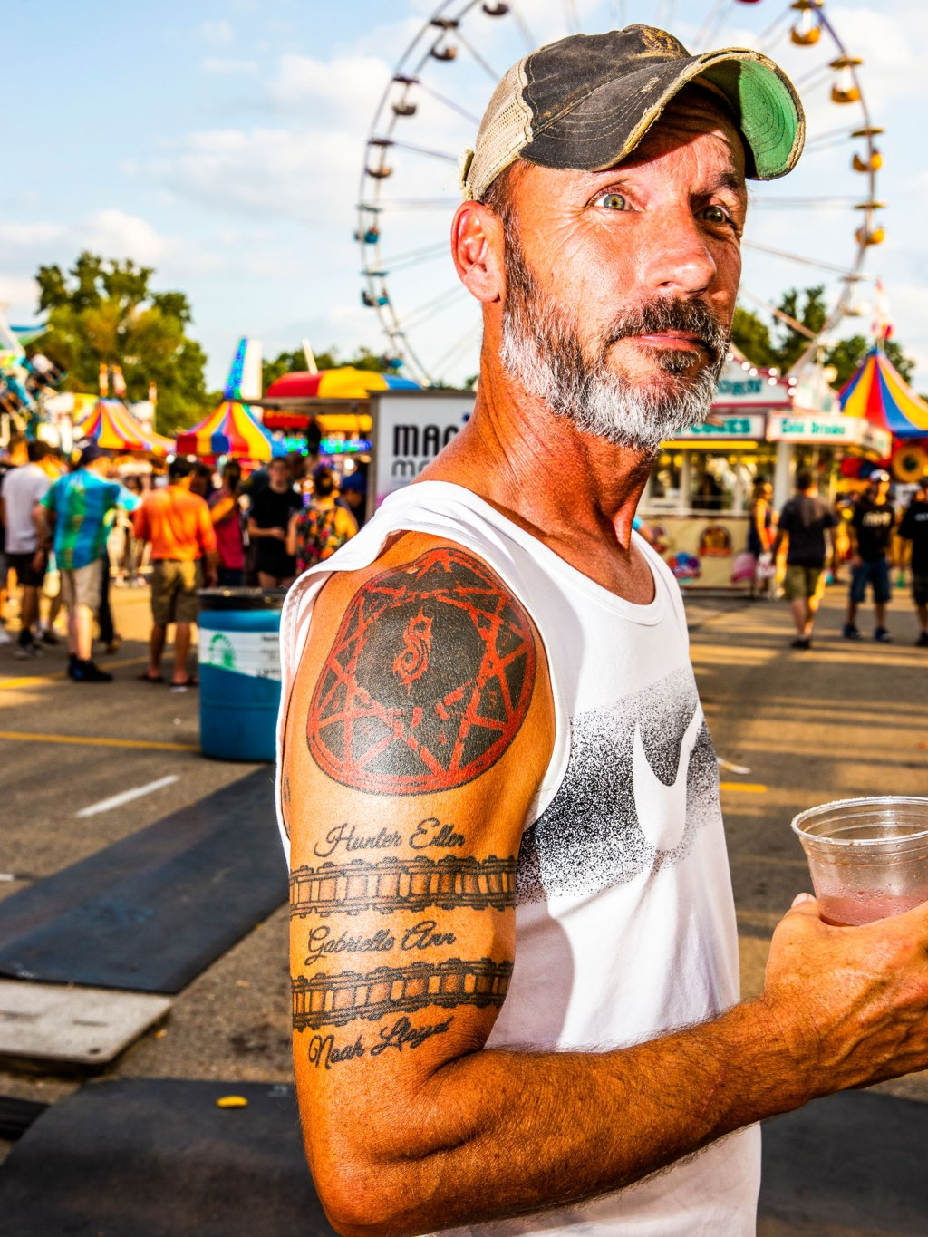 A Slipknot fan waits in line before Slipknot's homecoming show at the Iowa State Fair in Des Moines, Iowa on August 10, 2019.