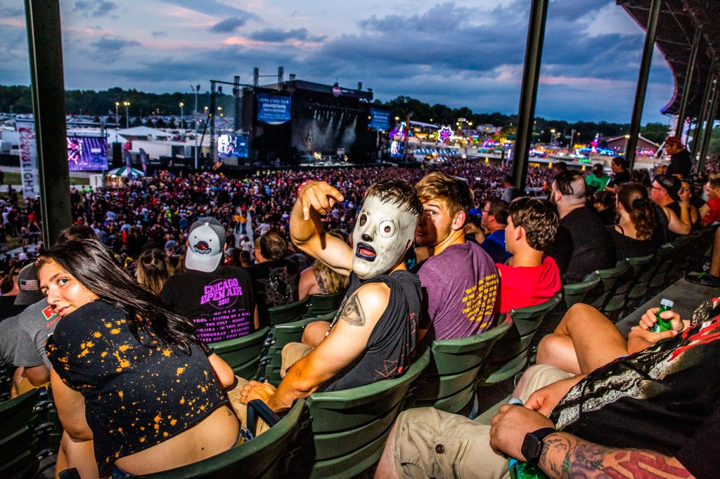 Fans waits for Slipknot to take the stage at the Iowa State Fair in Des Moines, Iowa on August 10, 2019.