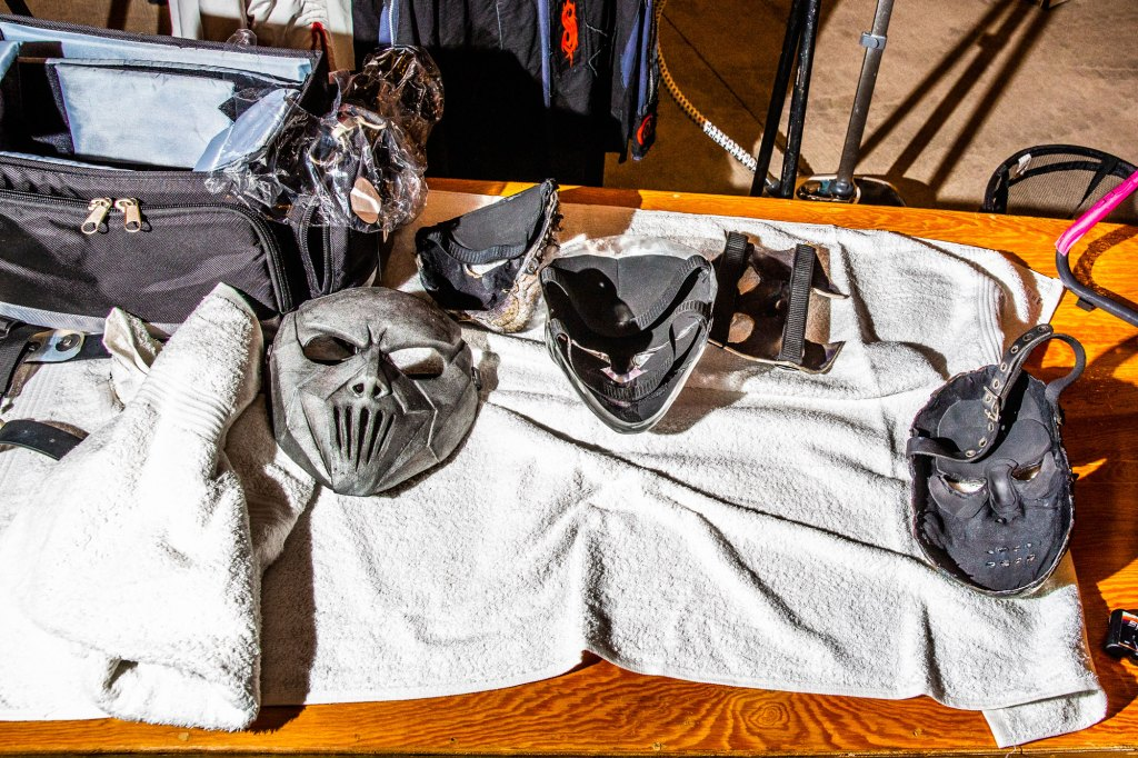 Various masks sit in the dressing room backstage at Slipknot's homecoming show at the Iowa State Fair in Des Moines, Iowa on August 10, 2019.
