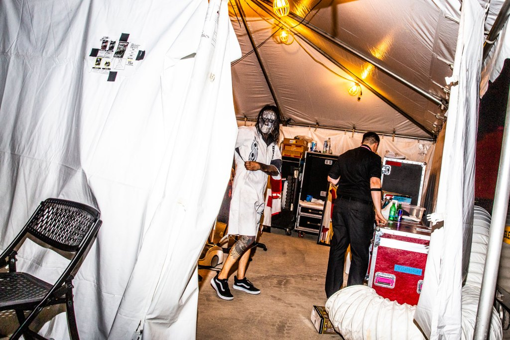 Drummer Jay Weinberg puts on the final touches in the dressing room before performing at the Iowa State Fair in Des Moines, Iowa on August 10, 2019.