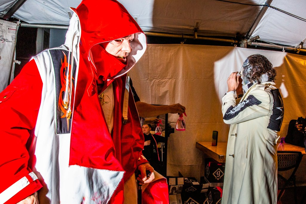 Turntable and keyboard player Sid Wilson (left) and singer Corey Taylor get ready before performing at the Iowa State Fair in Des Moines, Iowa on August 10, 2019.