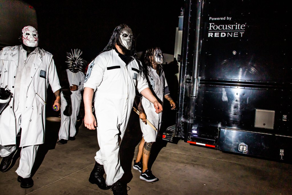 The band walks to the stage at the Iowa State Fair in Des Moines, Iowa on August 10, 2019.