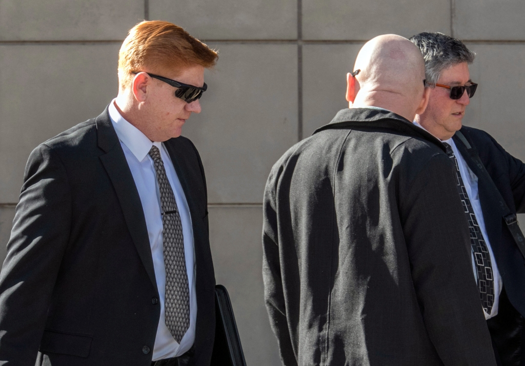 File - In a Wednesday, March 21, 2018 file photo, Border Patrol agent Lonnie Swartz, left, makes his way to the U.S. District Court building in downtown Tucson, Ariz. A jury in Arizona has acquitted a U.S. Border Patrol agent of manslaughter in the cross-border shooting death of a Mexican teen six years ago. Jurors found Swartz not guilty of involuntary manslaughter Wednesday, Nov. 21, 2018. It was his second trial after another jury acquitted him of second-degree murder and deadlocked on the manslaughter charge earlier this year. (Ron Medvescek/Arizona Daily Star via AP, File)