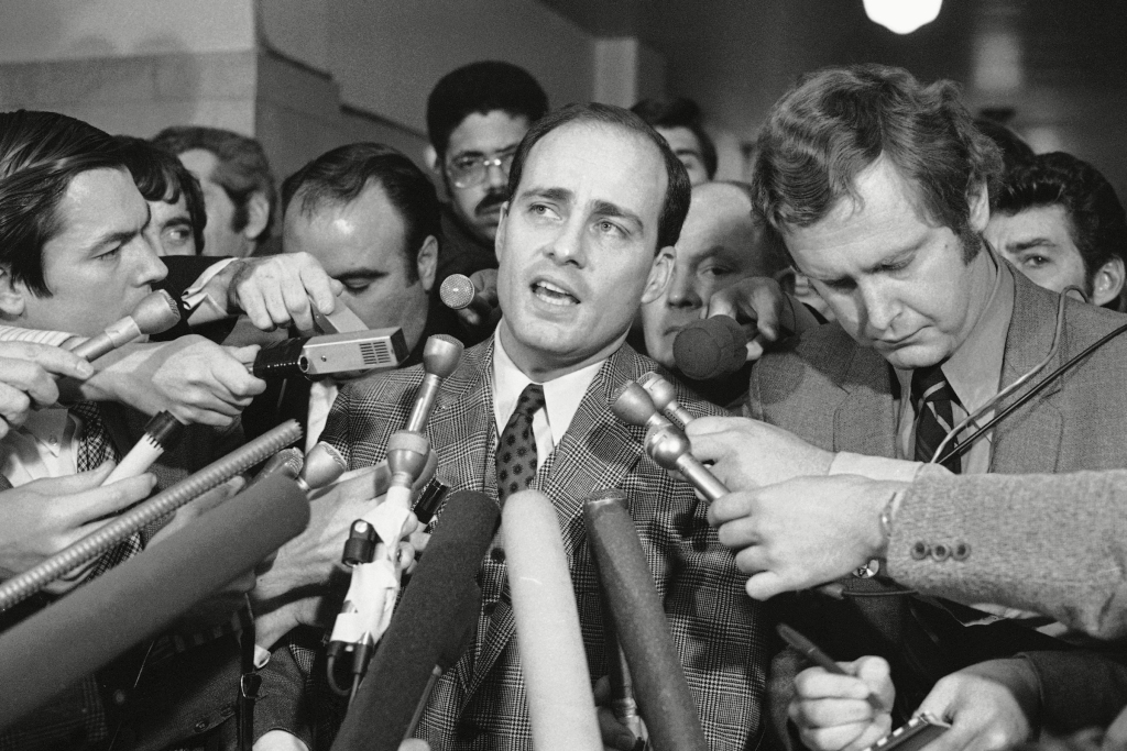 Vincent Bugliosi, Chief Prosecutor in the trial of Manson and three young women, talks with newsmen outside the courtroom in Los Angeles.