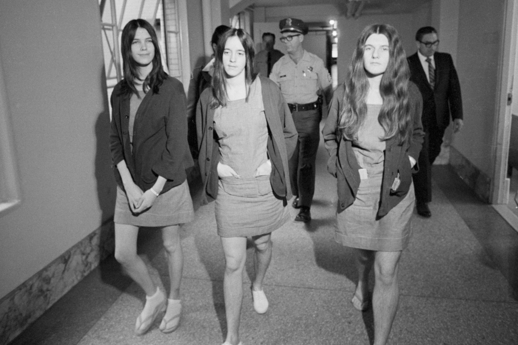 The three female defendants in the Tate-LaBianca murder trial walk from the jail section to the courtroom as their trial continues. The girls are (left to right) Leslie Van Houten, Susan Atkins, and Patricia Krenwinkel.