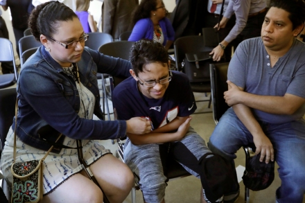 Gary Sanchez, of Honduras, right, watches as his wife, Mariela comforts their son, Jonathan, 16, during a news conference, in Boston. The Sanchez family came to the United States seeking treatment for Jonathan's cystic fibrosis. Doctors and immigrant advocates say federal immigration authorities are unfairly ordering foreign born children granted deferred action for medical treatment to return to their countriesImmigration Medical Treatment, Boston, USA - 26 Aug 2019