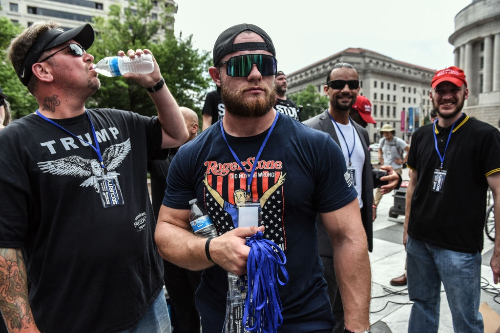 """WASHINGTON, DC - JULY 06: Proud Boys provide security during a """"Demand Free Speech"""" rally on Freedom Plaza on July 6, 2019 in Washington, DC. The demonstrators are calling for an end of censorship by social media companies. (Photo by Stephanie Keith/Getty Images)"""