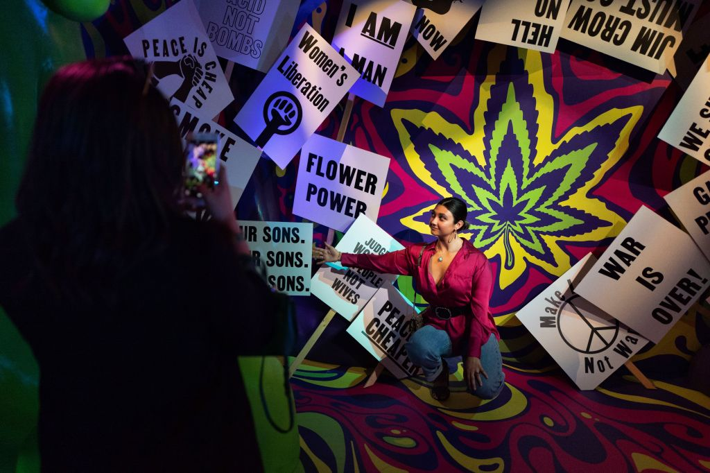 Visitors stop to take selfies while passing through one of the interactive displays at the Weedmaps Museum of Weed in Los Angeles. The 30,000 square foot museum was curated with interactive exhibits, Instagrammable art installations and historical artifacts. Visitors weaved their way through exhibits which include: Pre-Prohibition, Age of Madness, Counterculture Revolution, Behind Closed Doors, Entrapment, Dose of Compassion, Legalization and The Plant LabWeedmaps Museum of Weed, Los Angeles, USA - 01 Aug 2019