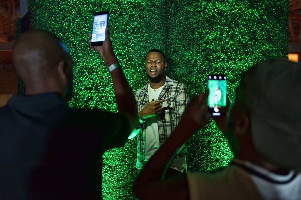 This photo shows guest take photos in front of a grass wall during the preview at the Weedmaps Museum of Weed in Los Angeles. The 30,000 square foot museum was curated with interactive exhibits, Instagrammable art installations and historical artifacts. Visitors weaved their way through exhibits which include: Pre-Prohibition, Age of Madness, Counterculture Revolution, Behind Closed Doors, Entrapment, Dose of Compassion, Legalization and The Plant LabWeedmaps Museum of Weed, Los Angeles, USA - 01 Aug 2019