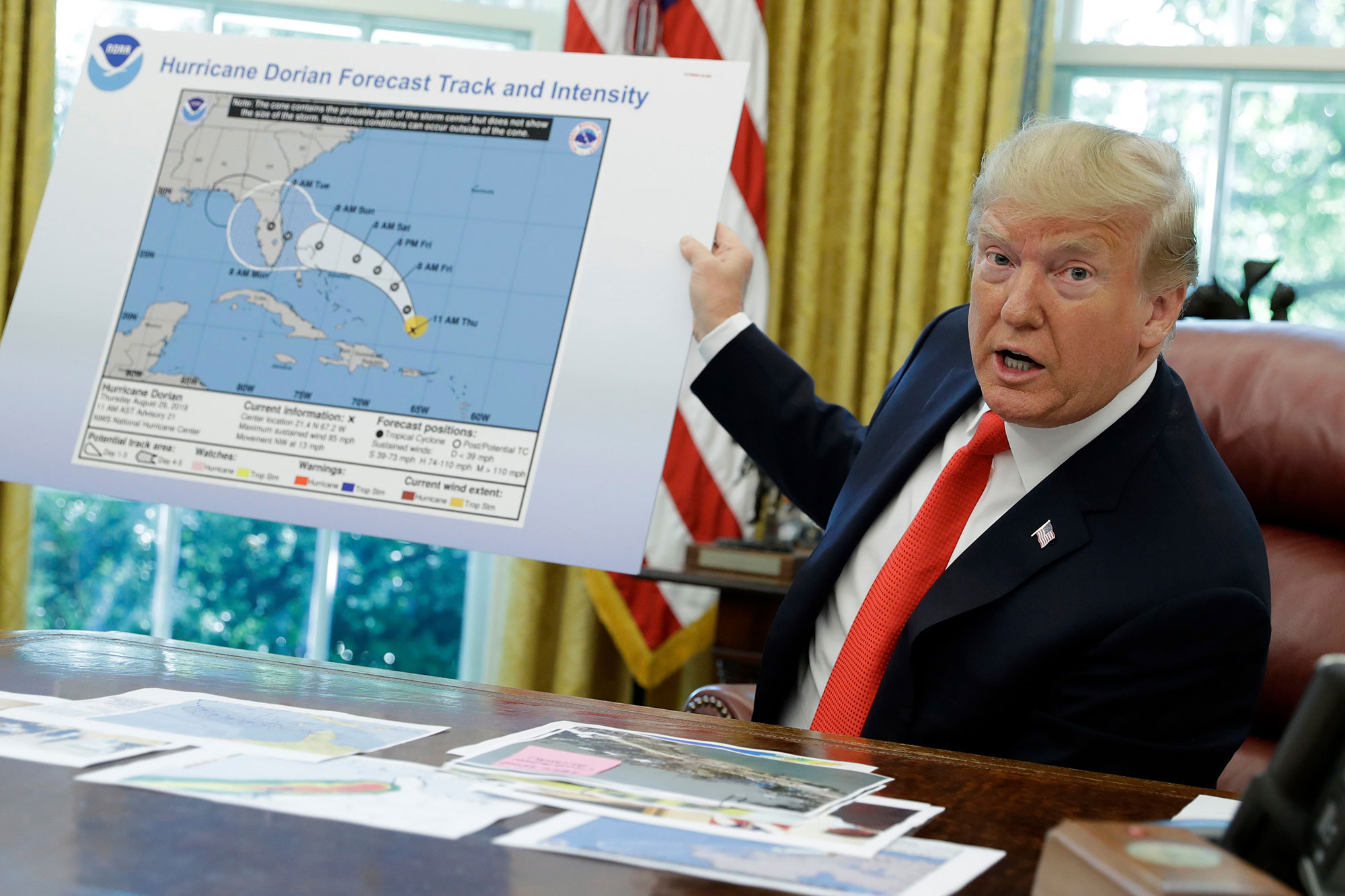 President Donald Trump speaks about Hurricane Dorian as he speaks to reporters in the Oval Office of the White House, in WashingtonTrump, Washington, USA - 04 Sep 2019