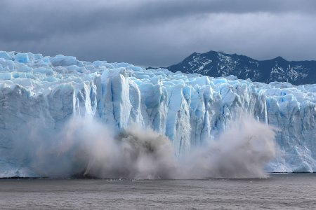 PERITO MORENO, ARGENTINA - APRIL 5: A piece of the Perito Moreno glacier, part of the Southern Patagonian Ice Field, breaks off and crashes into lake Argentina in the Los Glaciares National Park on April 5, 2019 in Santa Cruz province, Argentina. The ice fields are the largest expanse of ice in the Southern Hemisphere outside of Antarctica but according to NASA, are melting away at some of the highest rates on the planet as a result of Global Warming. (Photo by David Silverman/Getty Images)