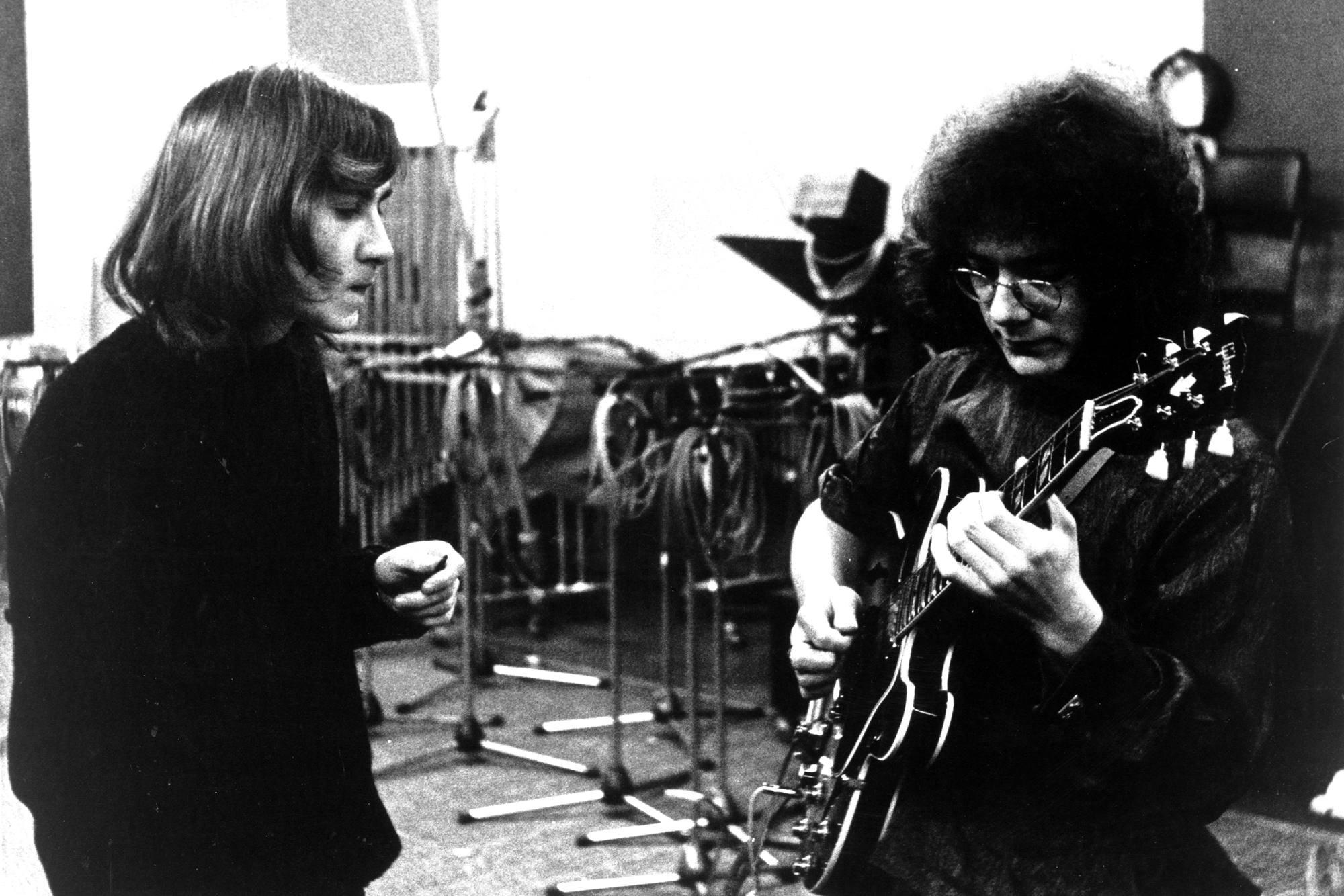 "(L-R) Lyricist Peter Sinfield and guitarist Robert Fripp of the first lineup of the English rock band ""King Crimson"" record in the studio in 1969."