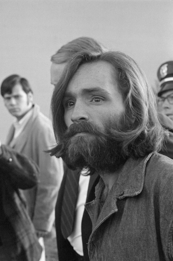 "Charles Manson arrives at Inyo County Courthouse in Independence, California, for a preliminary hearing on charges of arson and receiving stolen goods. He is alleged to be the leader of the ""Manson Family,"" a group whose members are suspected in the murders of actress Sharon Tate and four others."