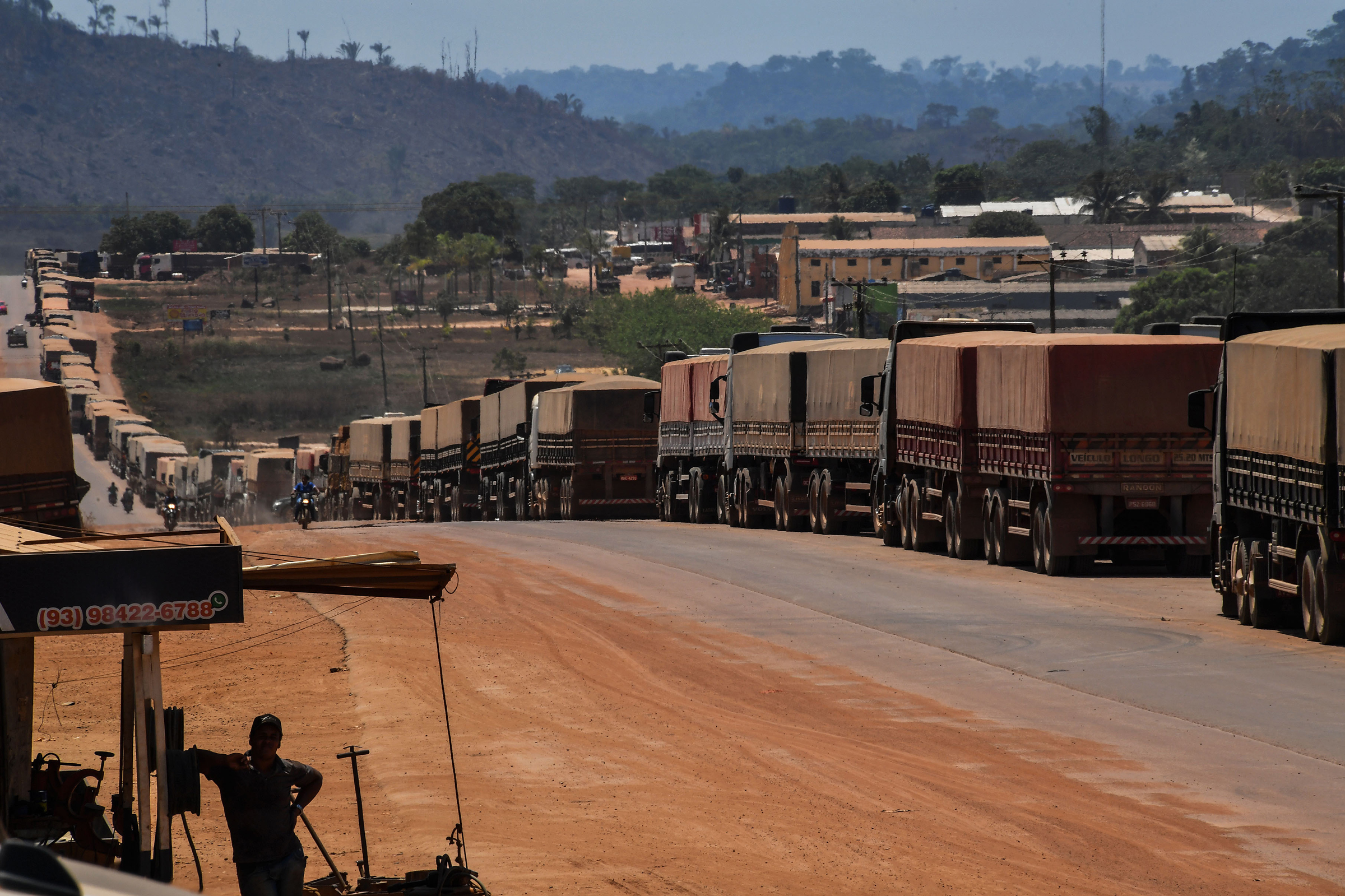 "Truckers line up on the BR 163 highway, blocked by ""garimpeiros"" -illegal gold miners- during a protest in Morais Almeida, Itaituba, Para state, Brazil, on September 13, 2019. - Members of an indigenous tribe in the Amazon in northern Brazil on Friday called for wildcat miners to be allowed to prospect for gold on their land, saying it was a source of income. (Photo by NELSON ALMEIDA / AFP) (Photo credit should read NELSON ALMEIDA/AFP/Getty Images)"